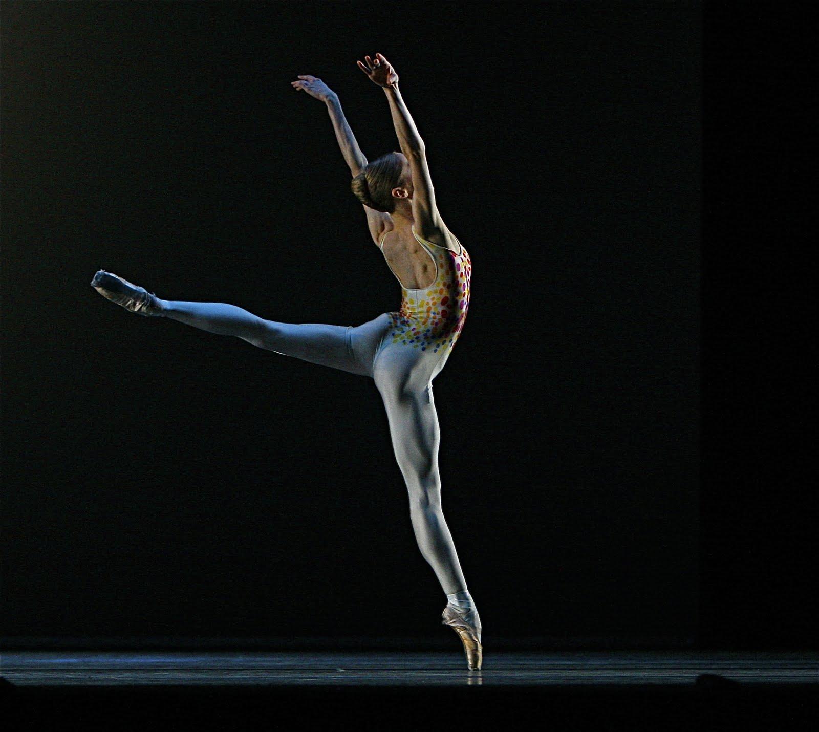 dancer in costume in jump