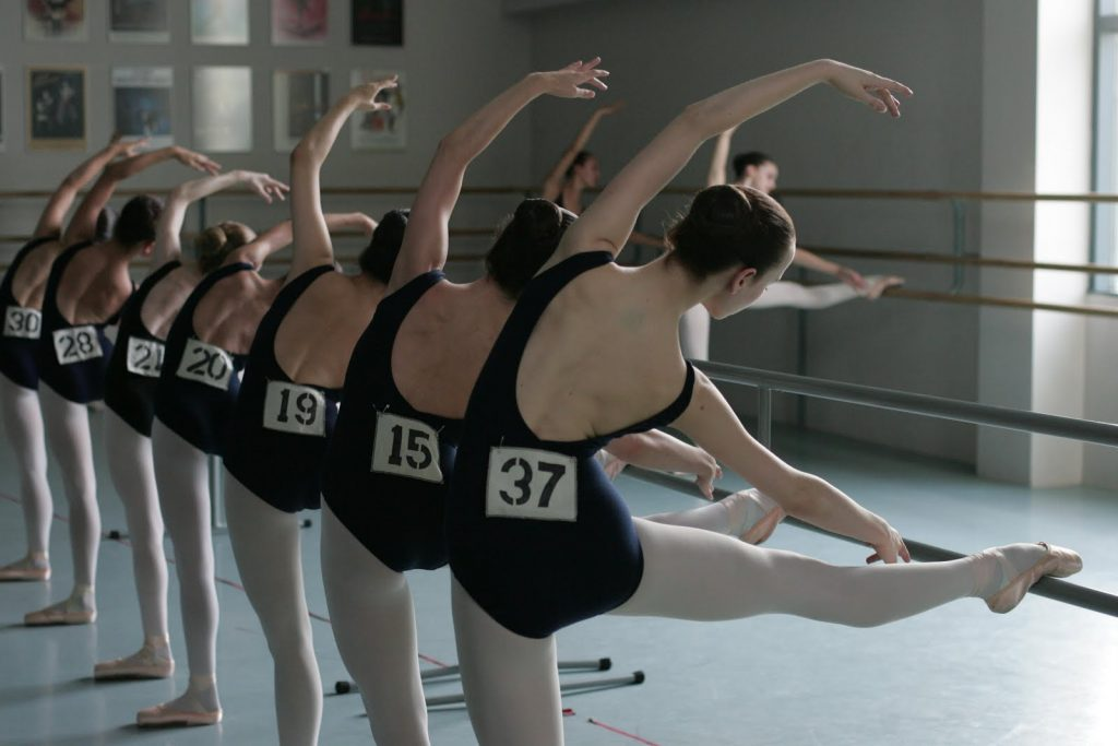 row of dancers at the barre