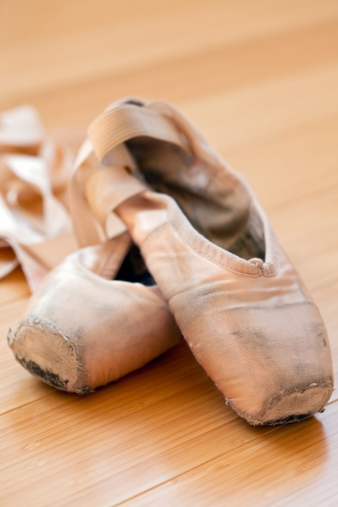 a battered pair of pointe shoes