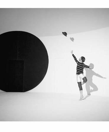 dancer jumps next to ball