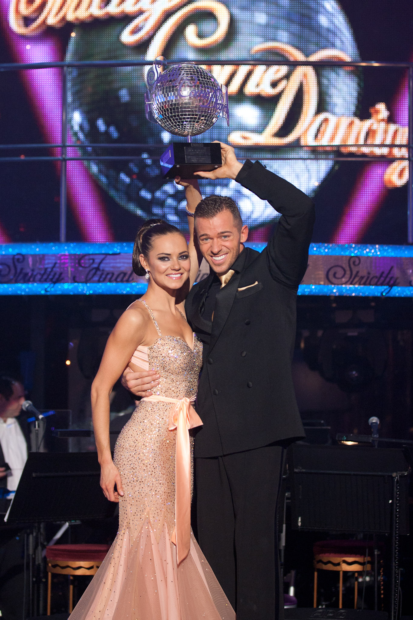 two strictly winners hold the glitterball
