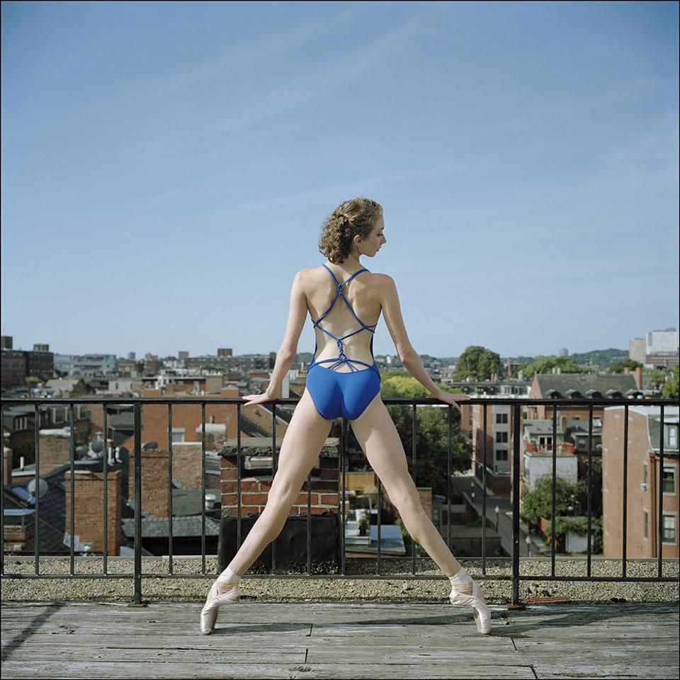 a ballet dancer stands on pointe