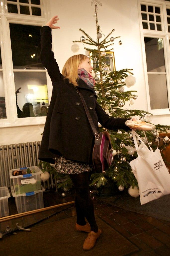 Hannah dances under the Christmas tree