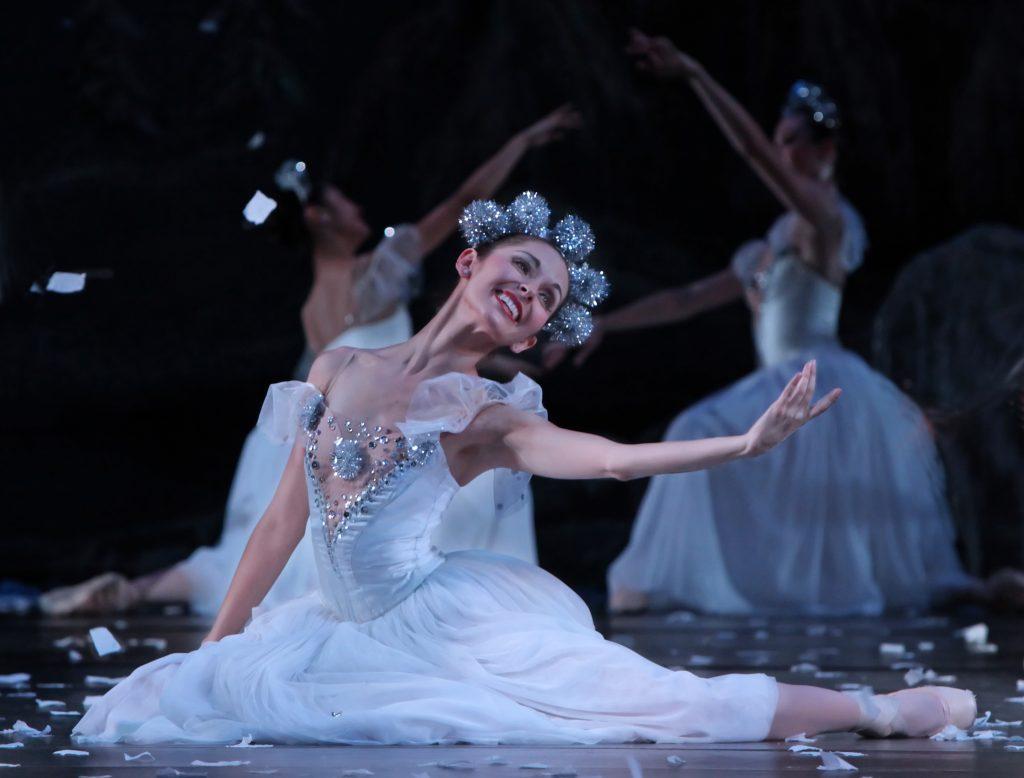 dancer kneeling on stage