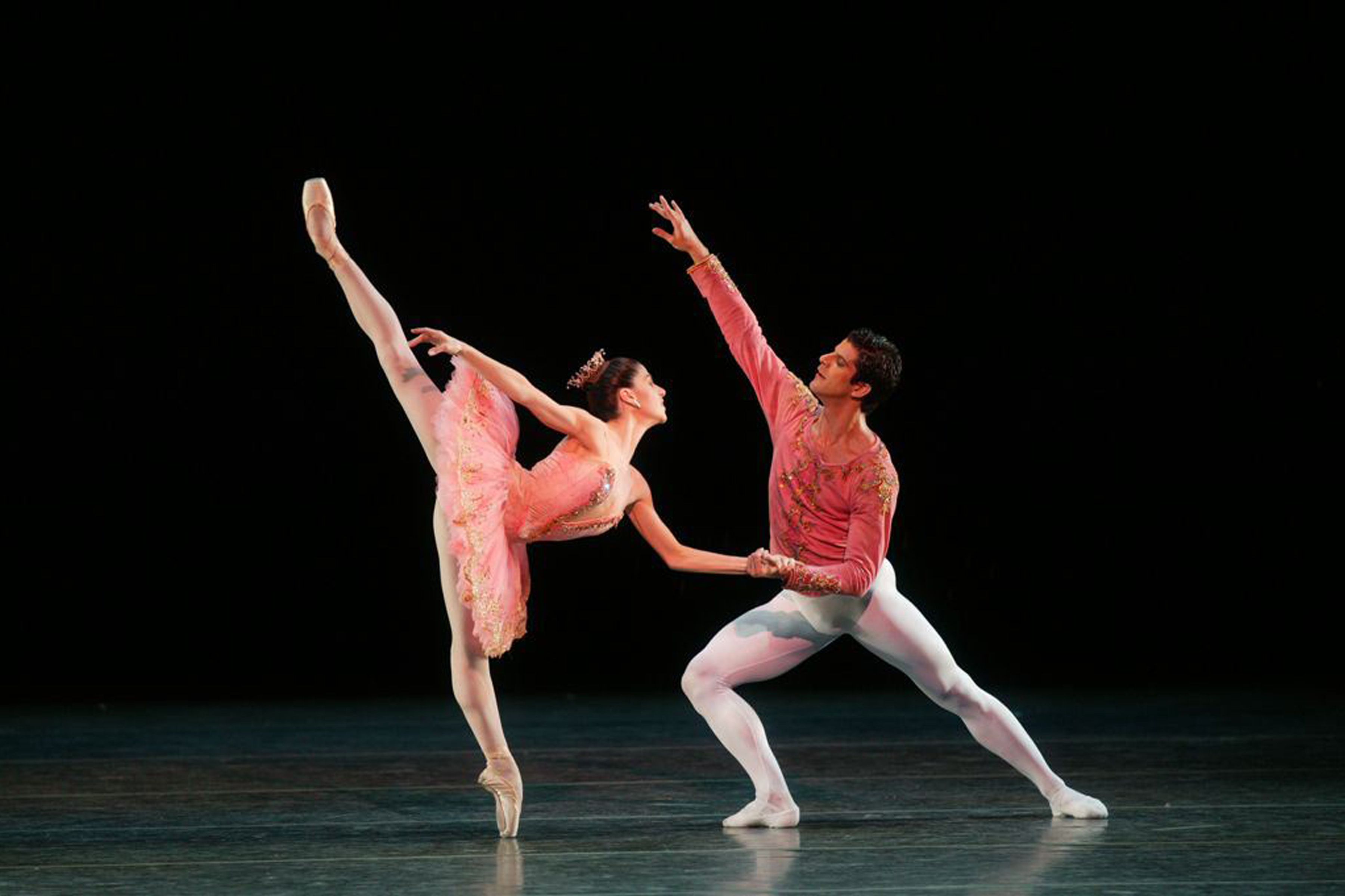 two dancers on stage in arabesque