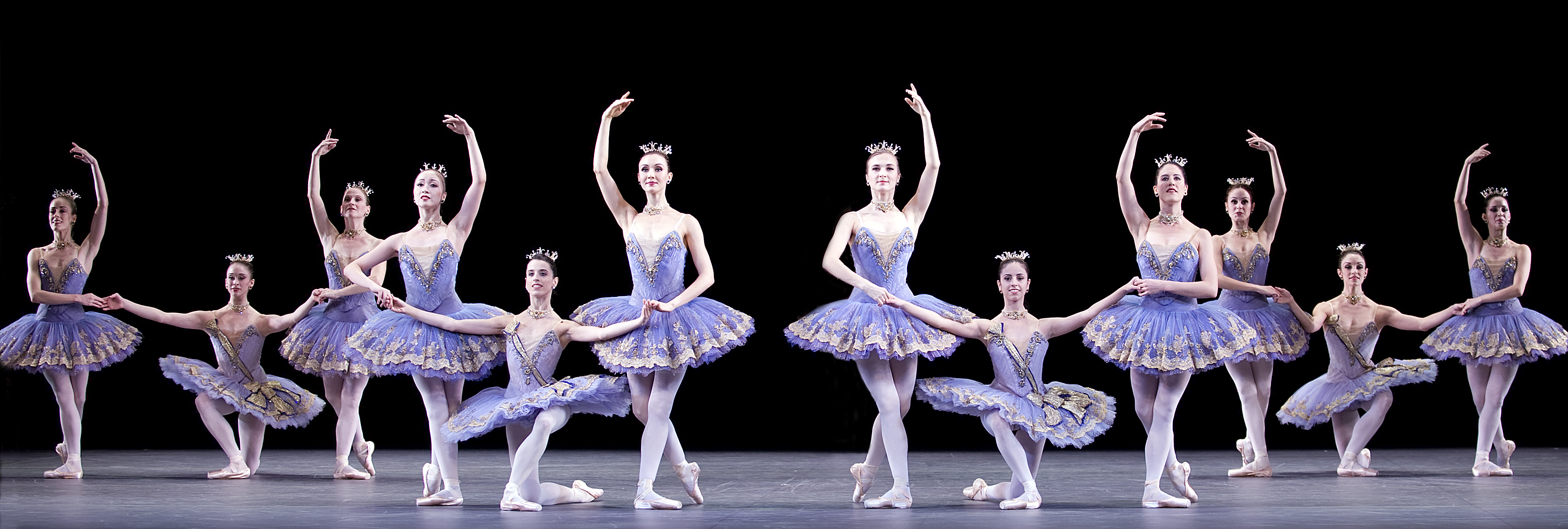 dancers in white tutus on stage
