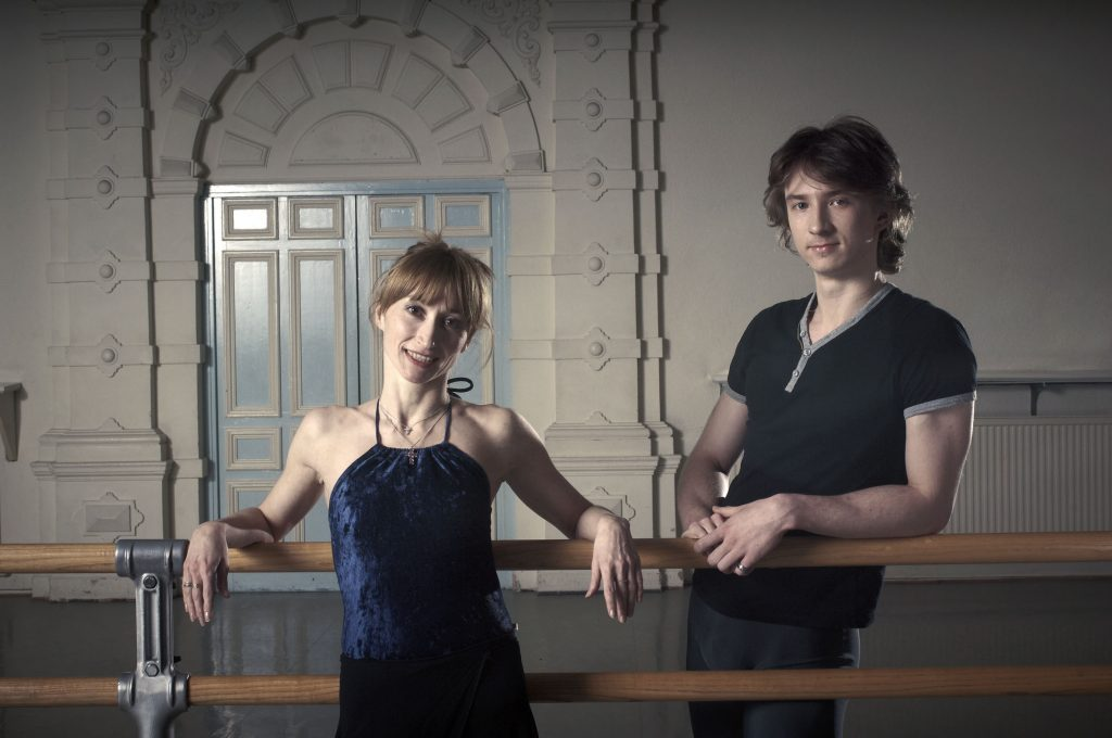 two ballet dancers at the barre one is Vadim Muntagirov