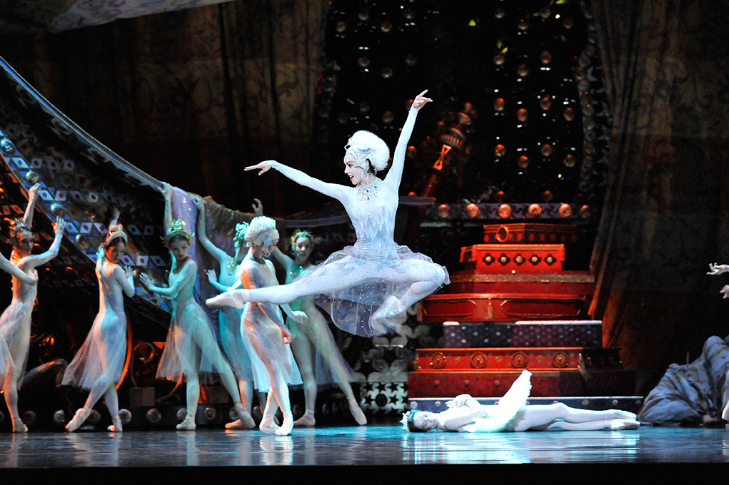 dancer jumping high in the air on stage