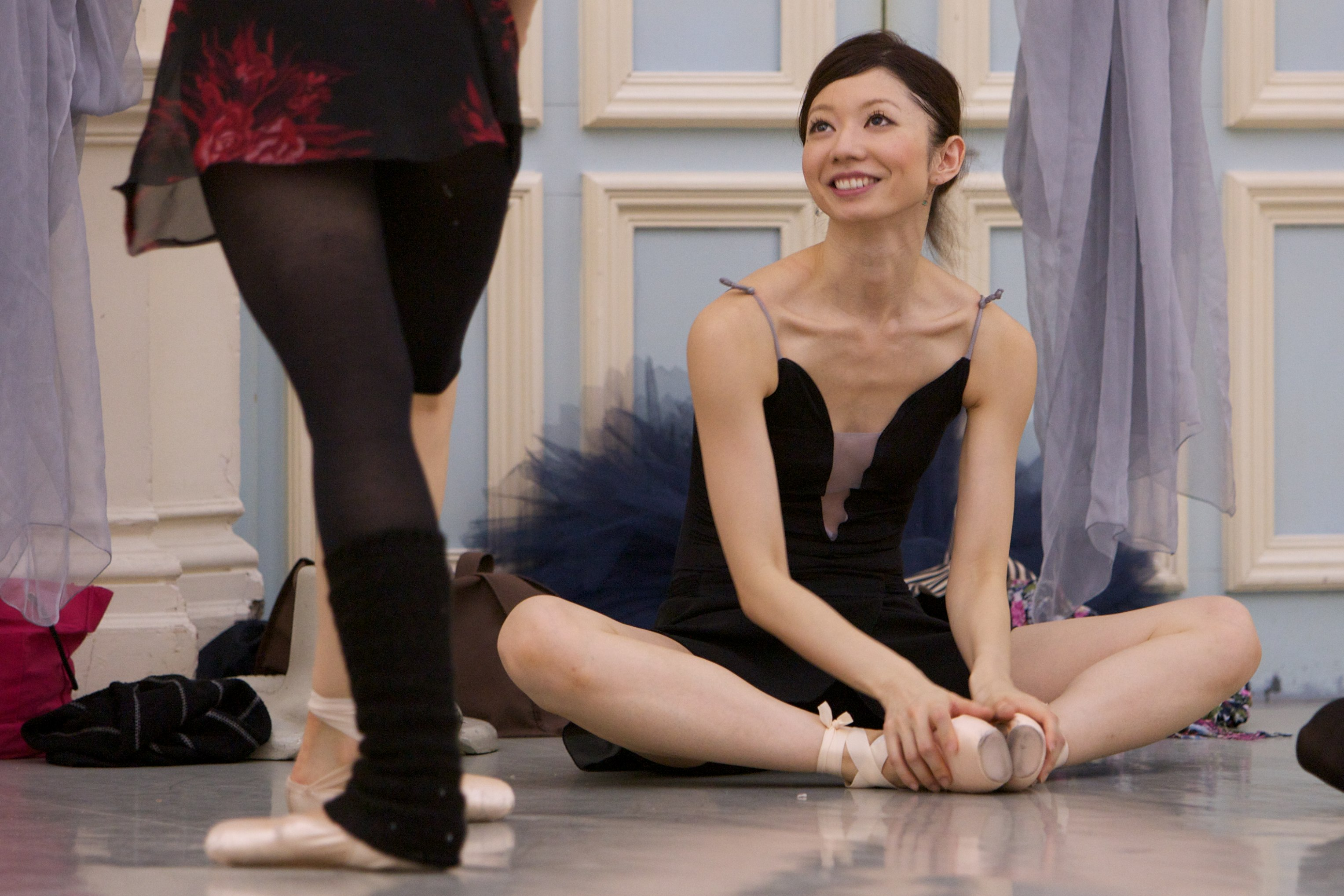 dancer sits on the floor with tutu