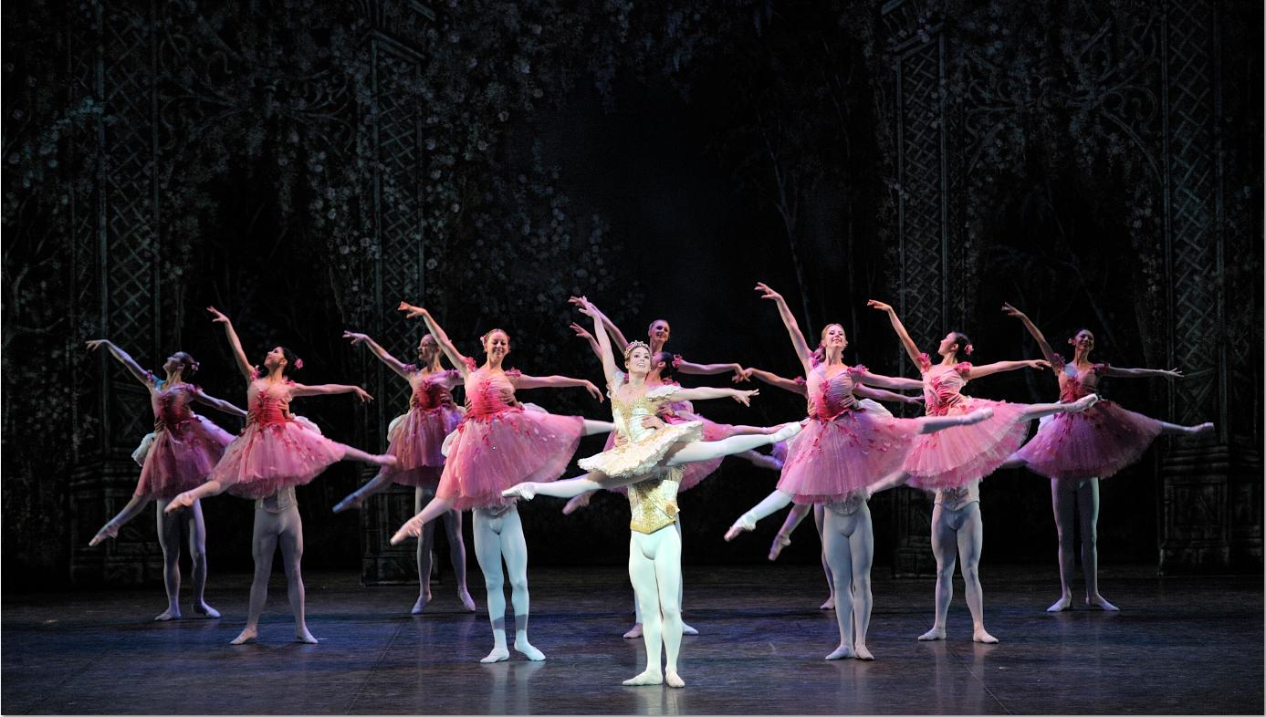 dancer in arabesque on stage in tutu