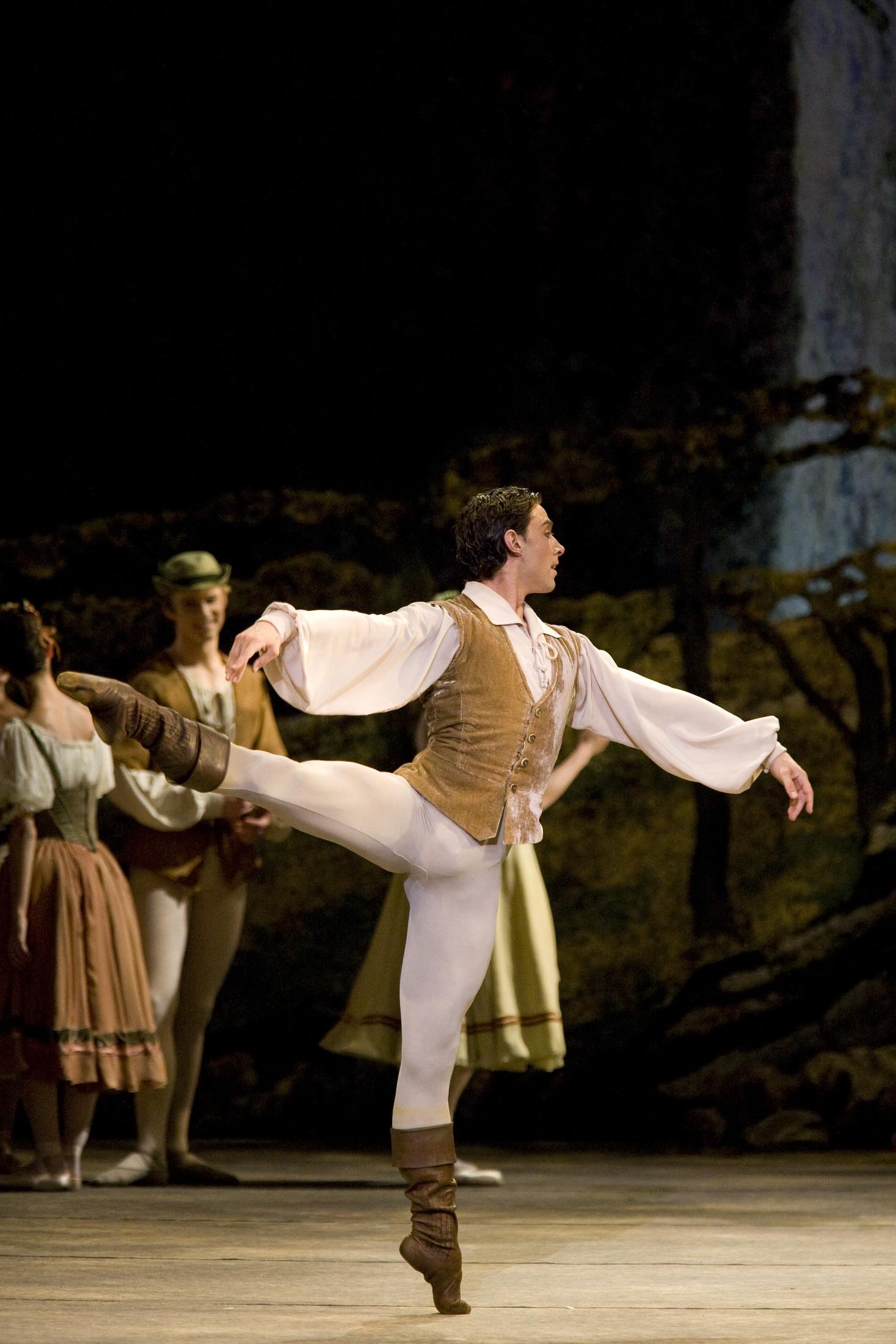 dancer in arabesque on stage