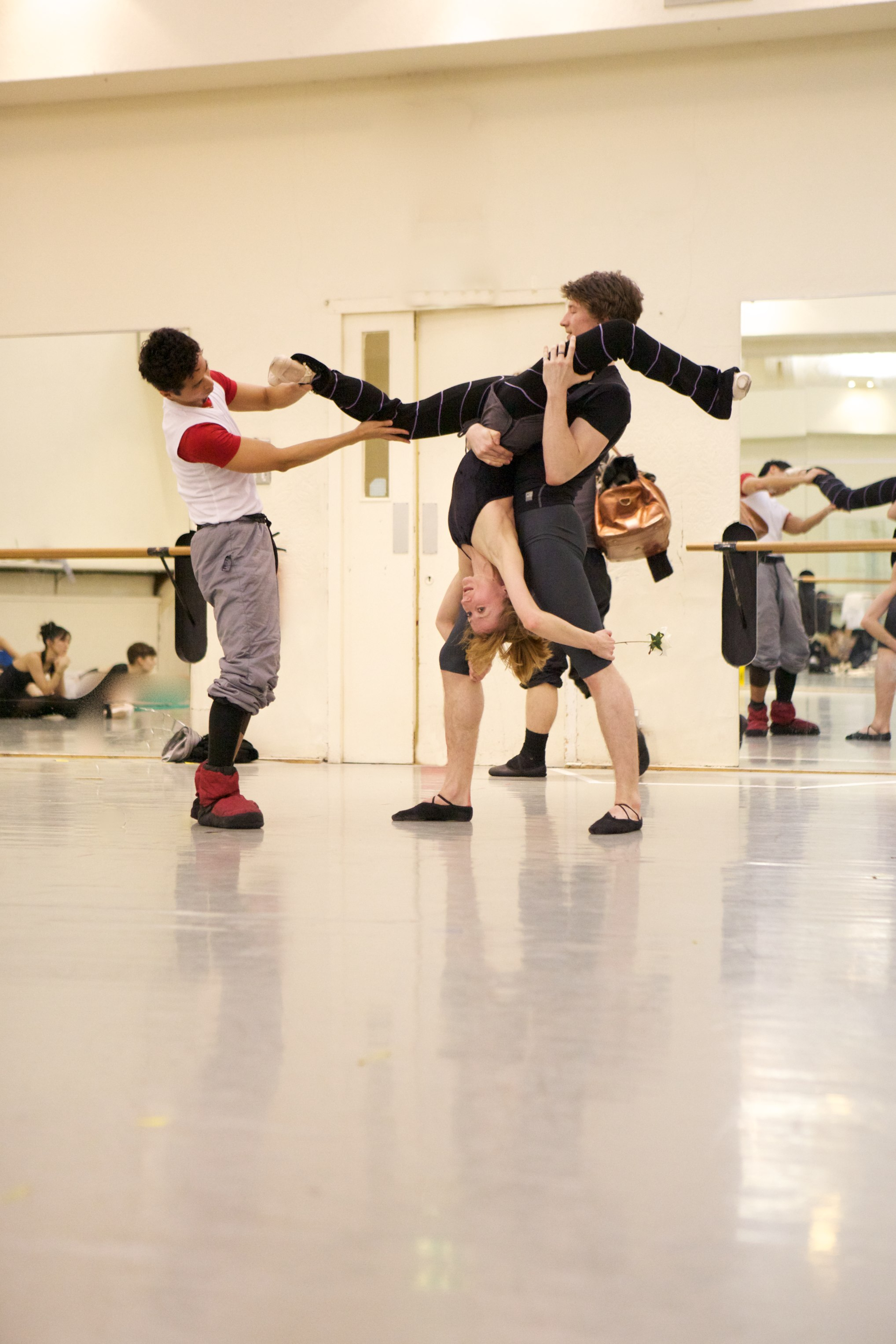 two dancers being coached by another
