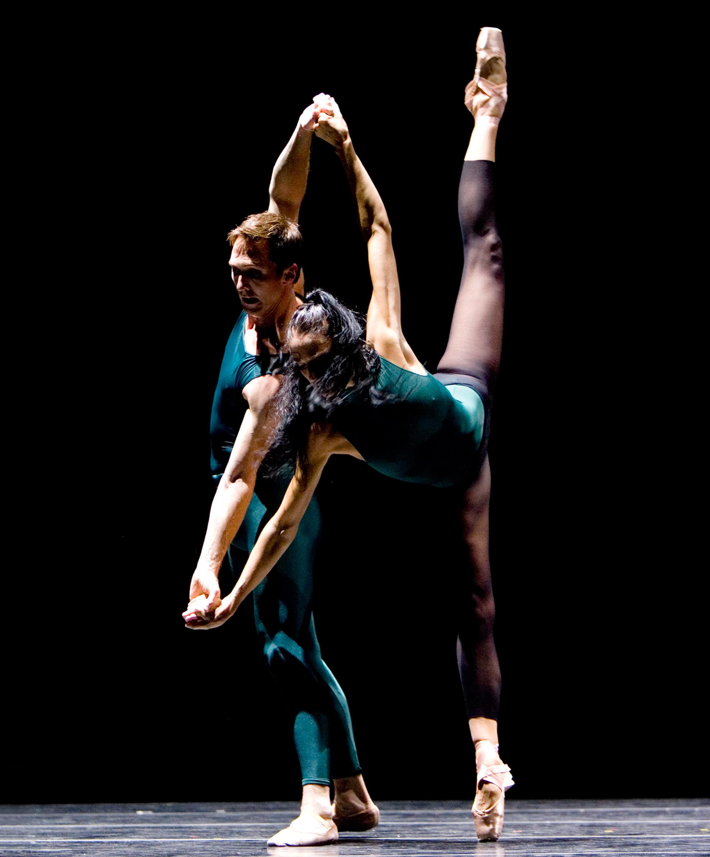 two dancers in pas de deux on stage