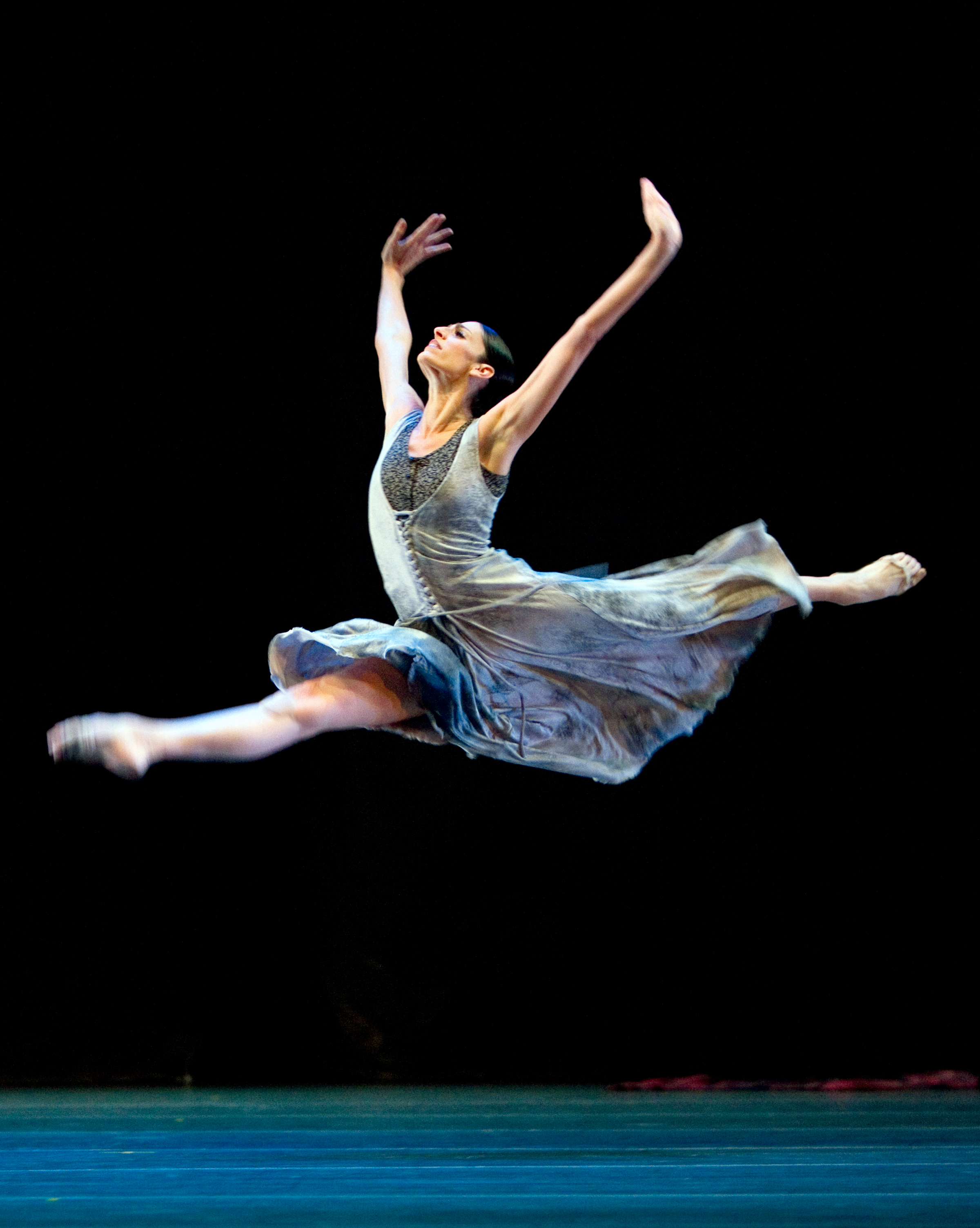 dancer in jete across the stage