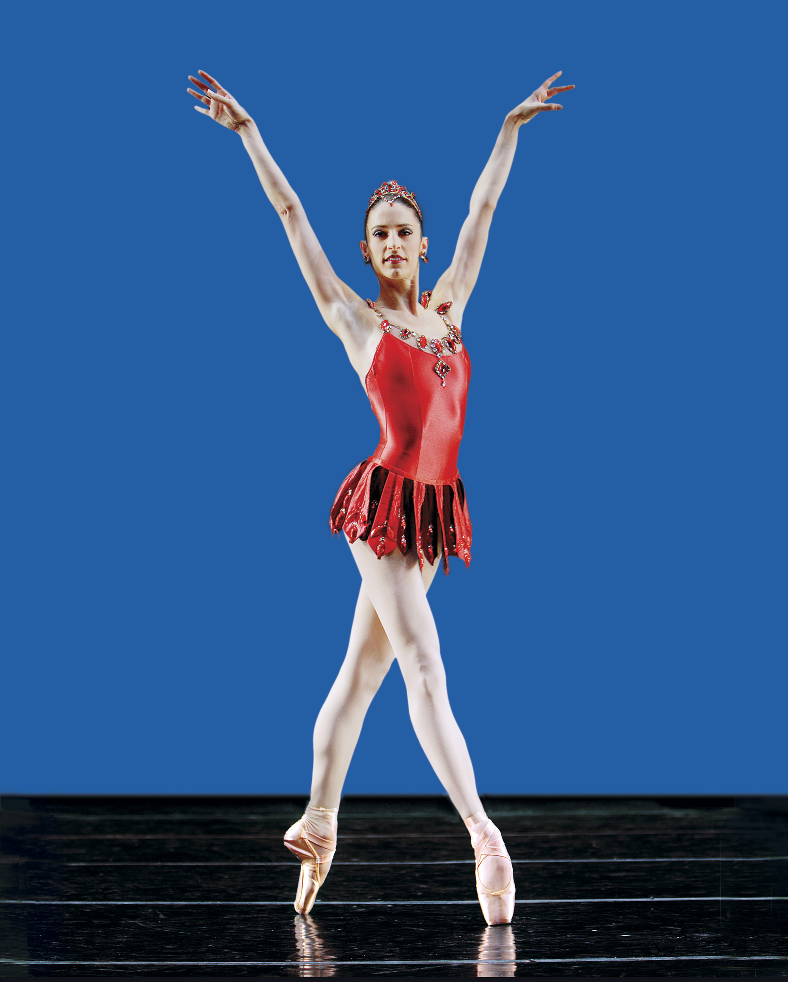 dancer in red leotard on pointe