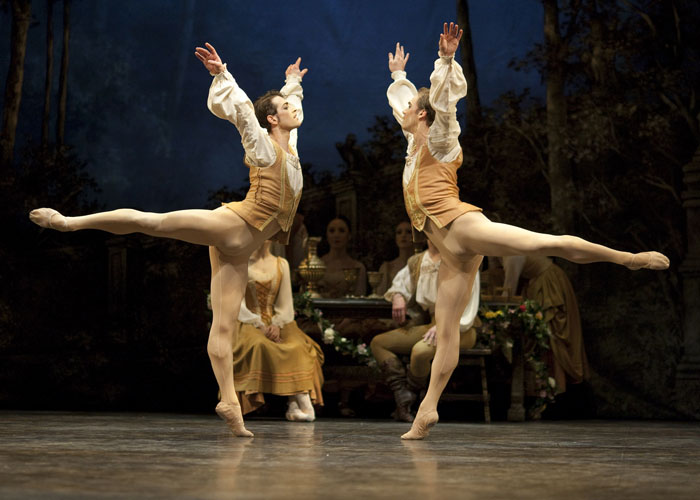 two ballet dancers in arabesque