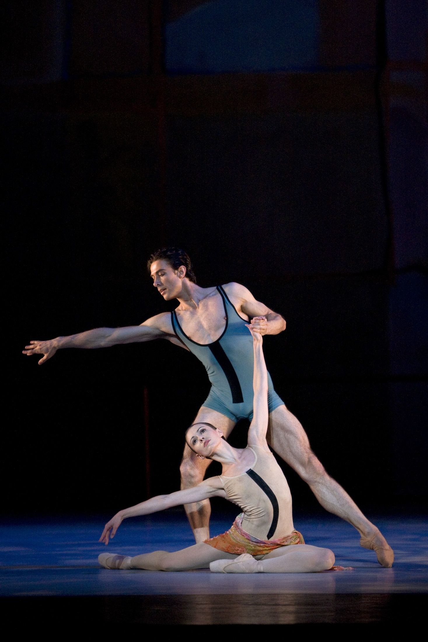 two dancers on stage in a ballet with dance clothes