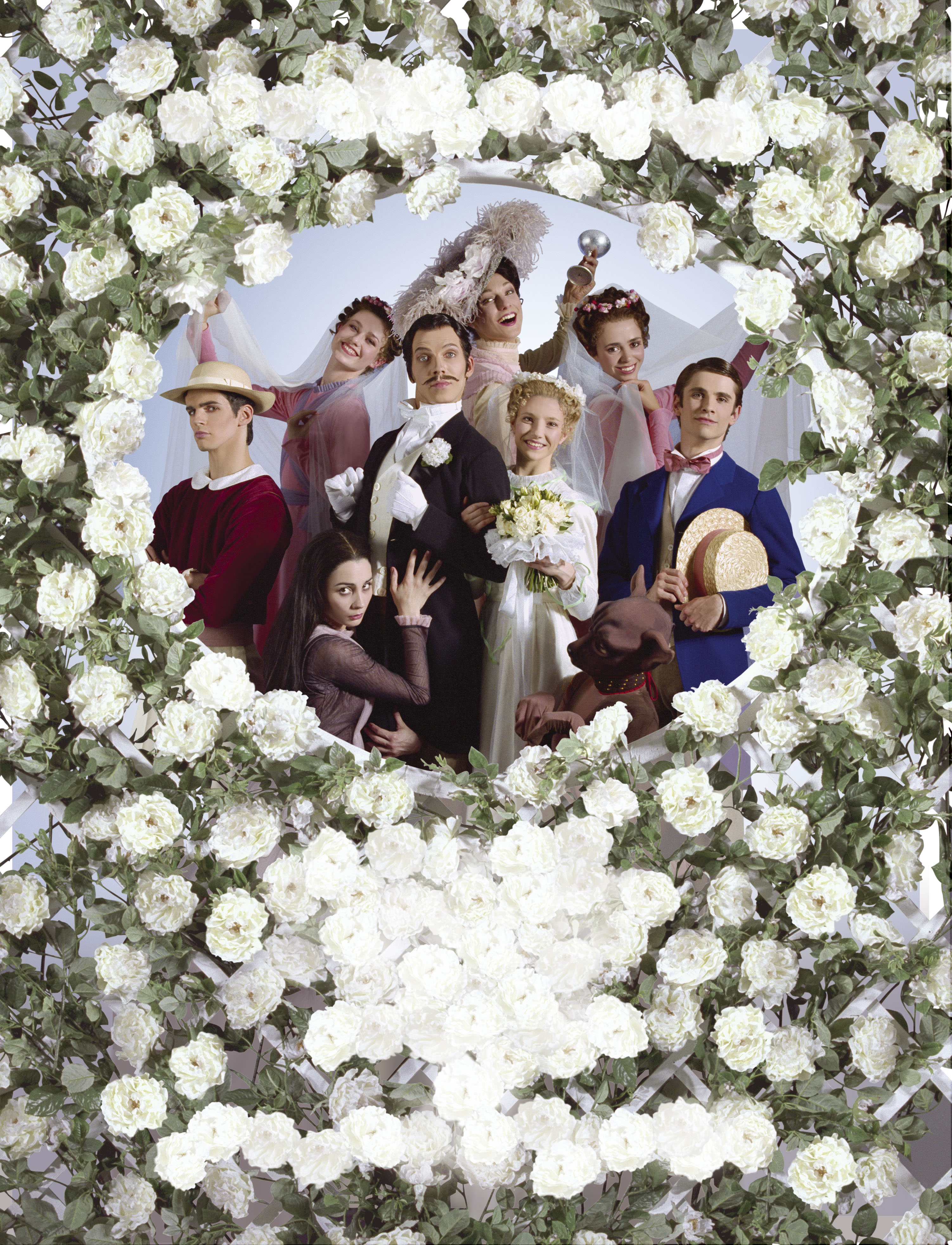 a group of dancers peeping through a bridal rose arch