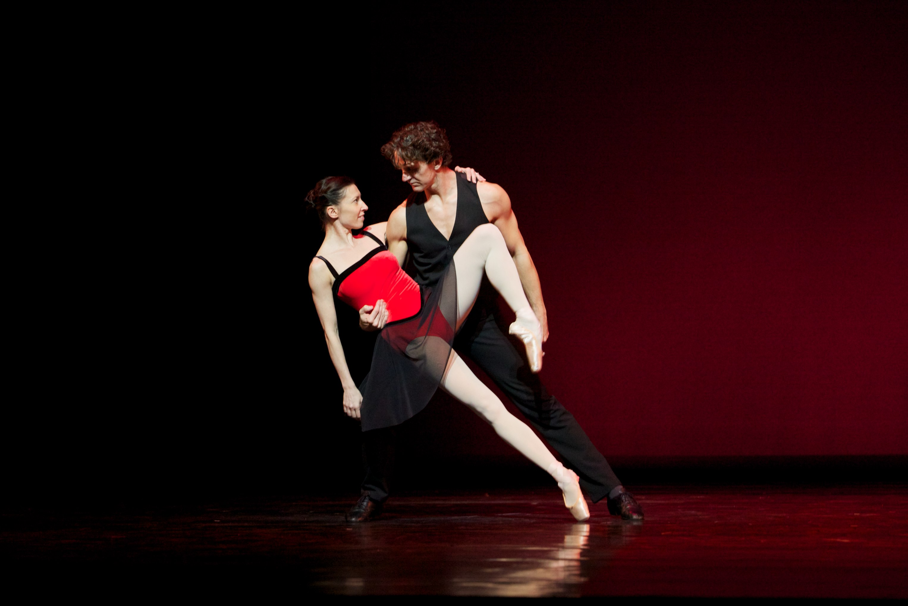 two dancers in a tango on stage