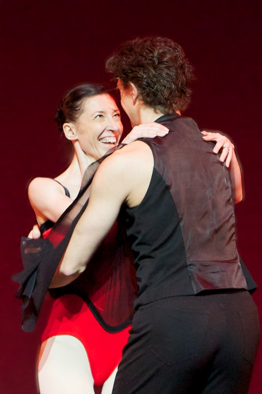 two dancers laughing on stage