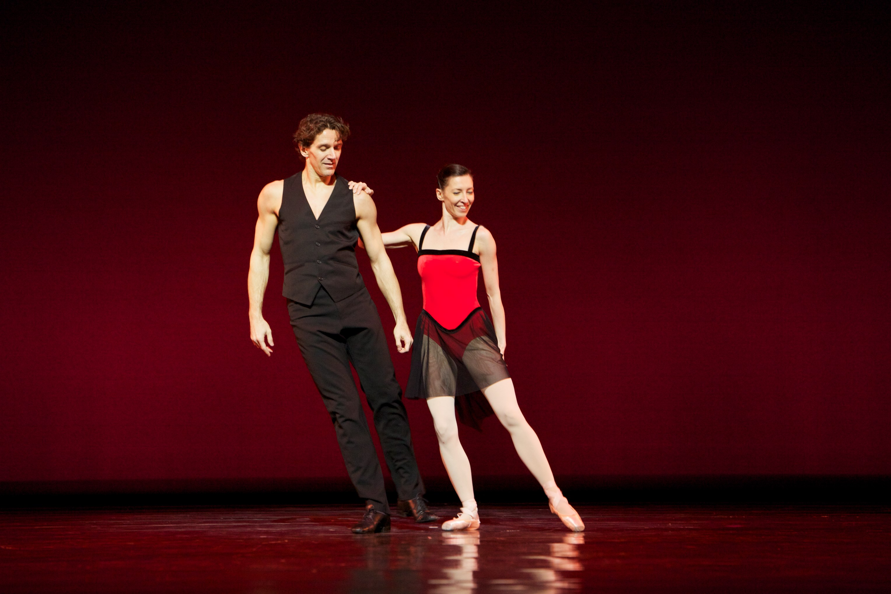 two dancers on stage in a ballet