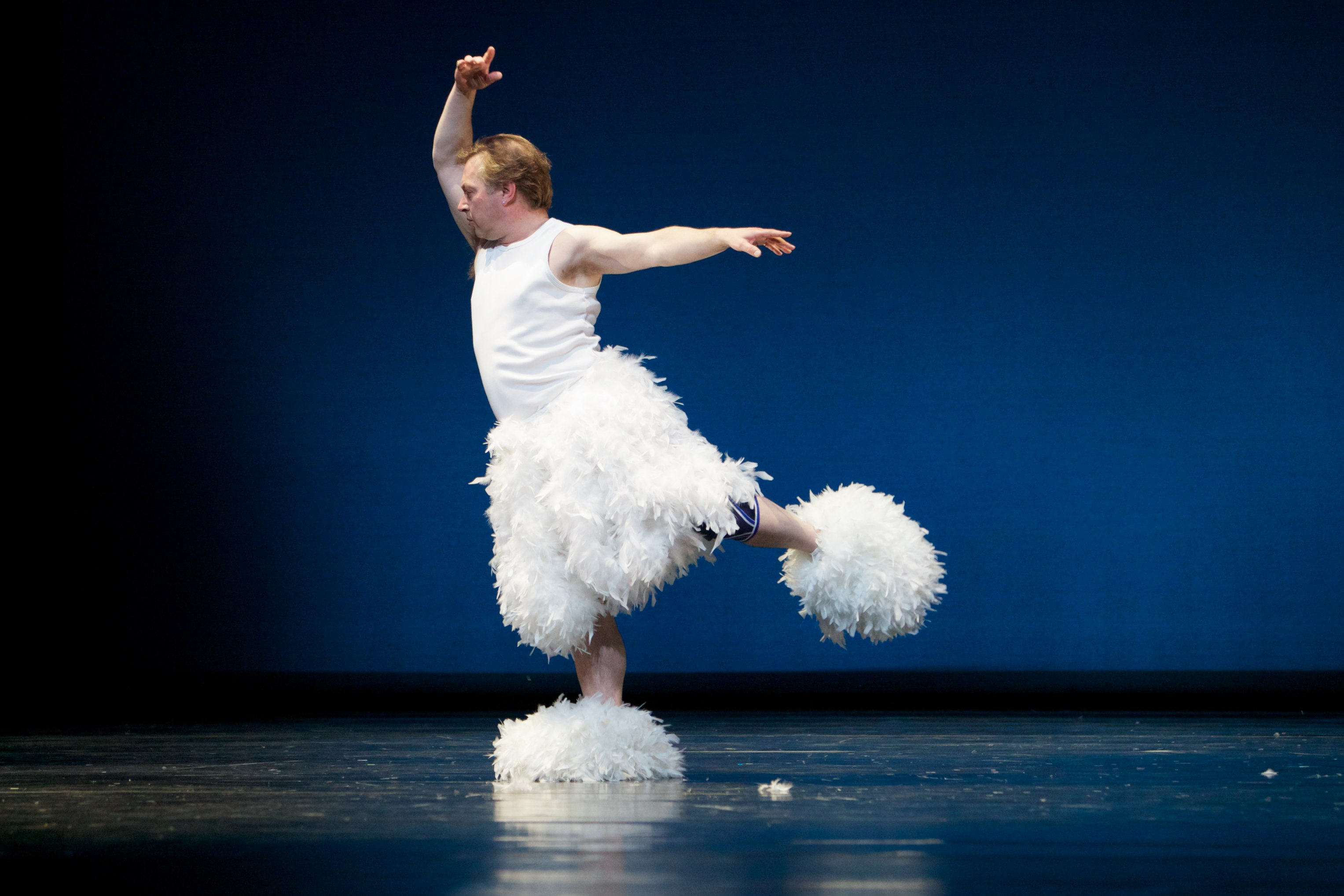 male dancer in white tutu and fluffy slippers