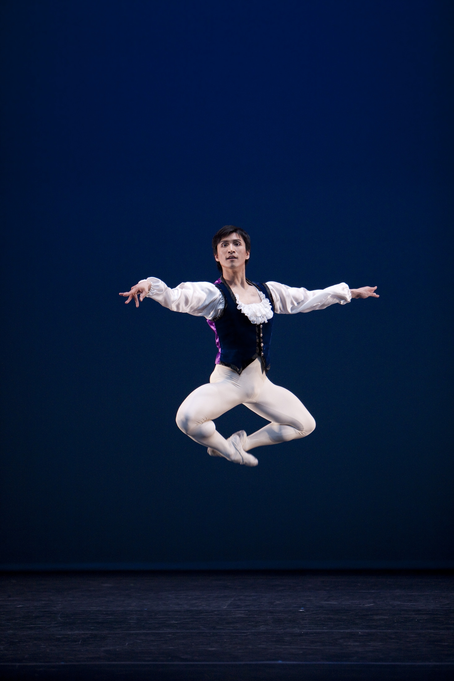 male ballet dancer in white tights jumping high
