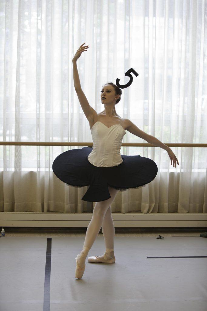dancer in black tutu and mad hat for Alice's Adventures in Wonderland