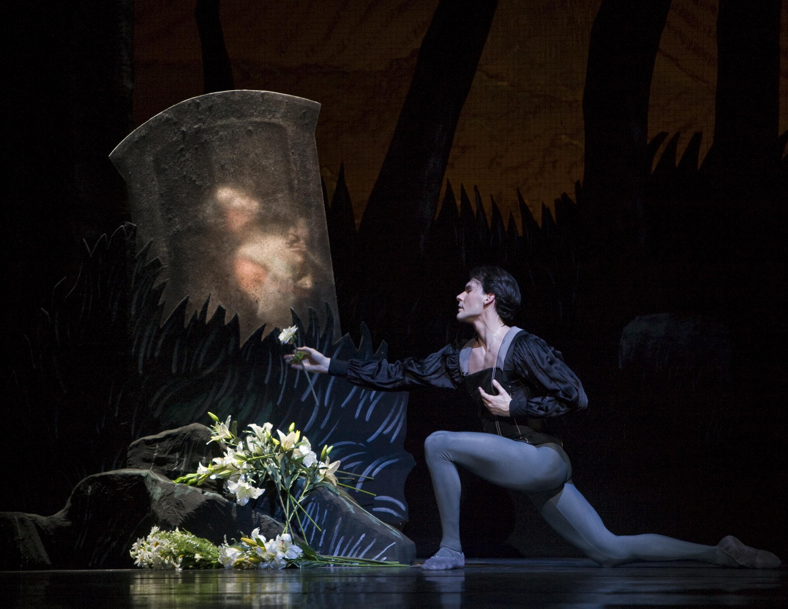 dancer kneels in front of grave in Giselle