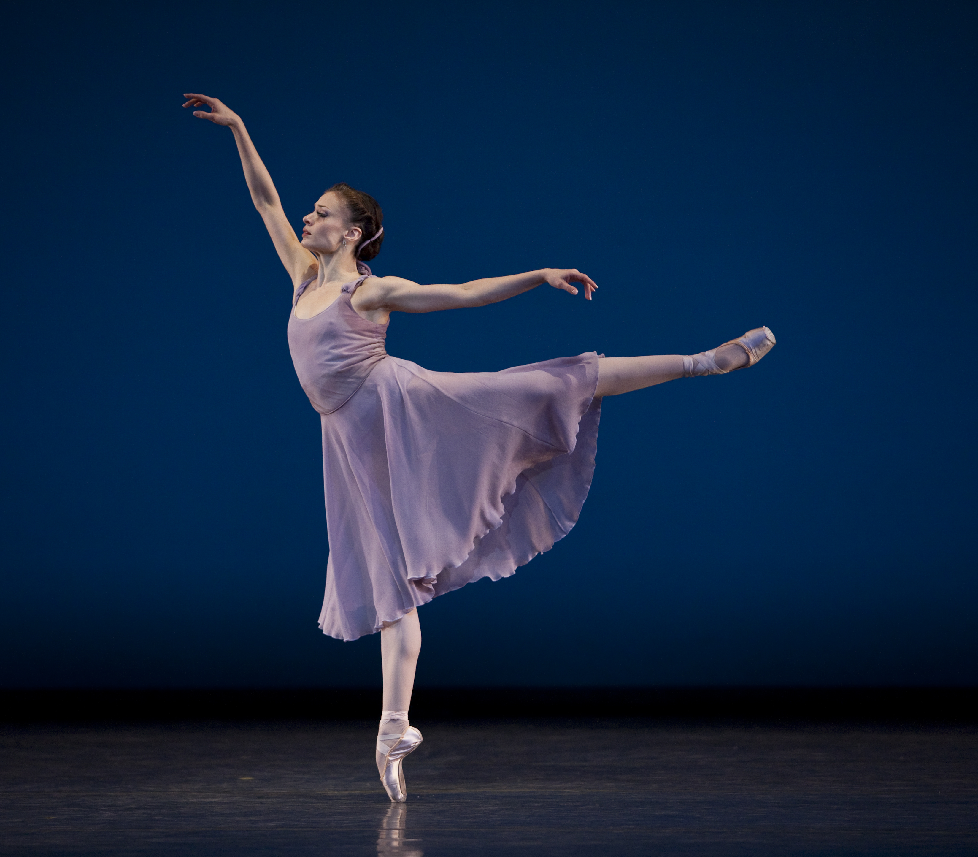 dancer stands on her pointe shoe