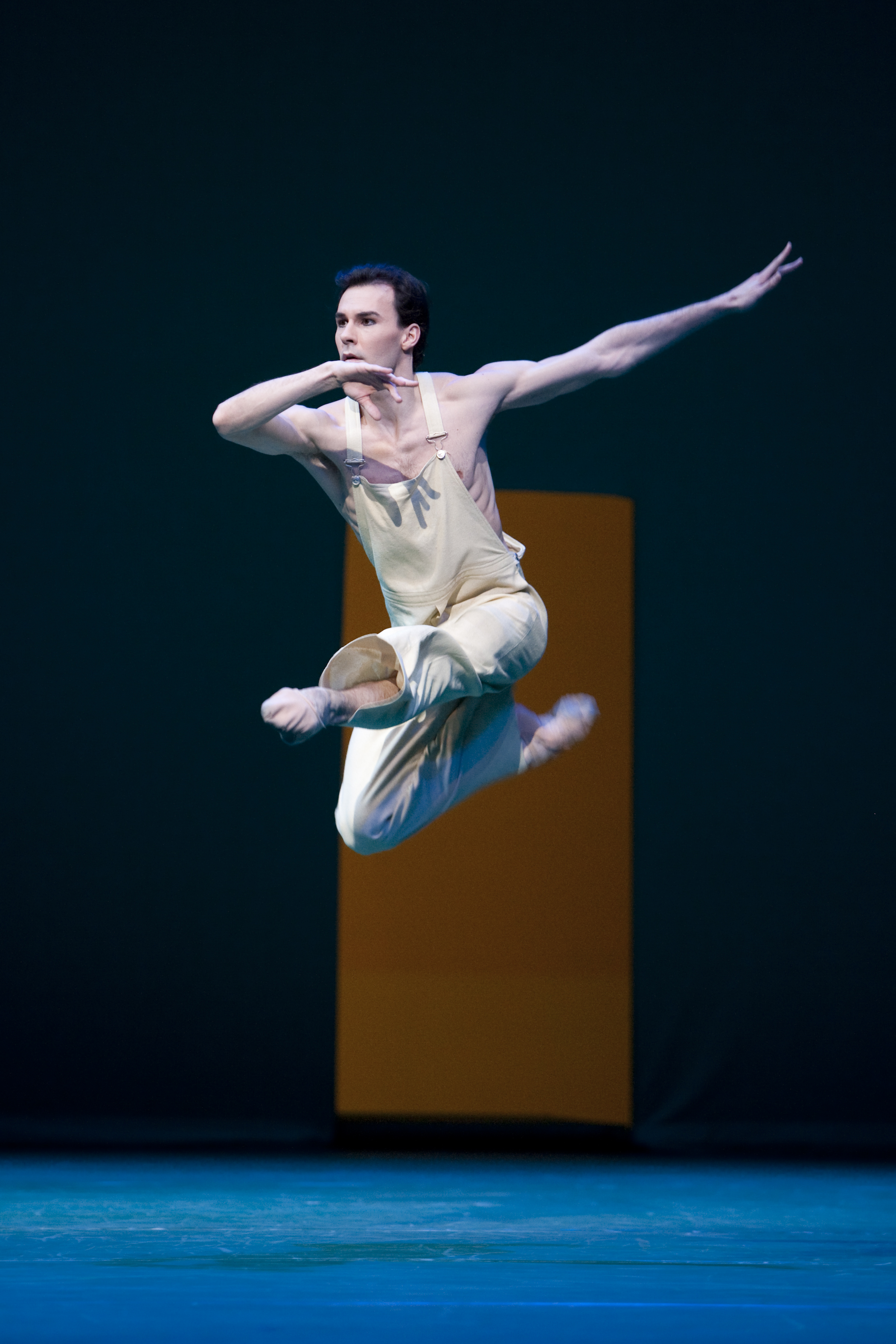 dancer jumps in the air on stage