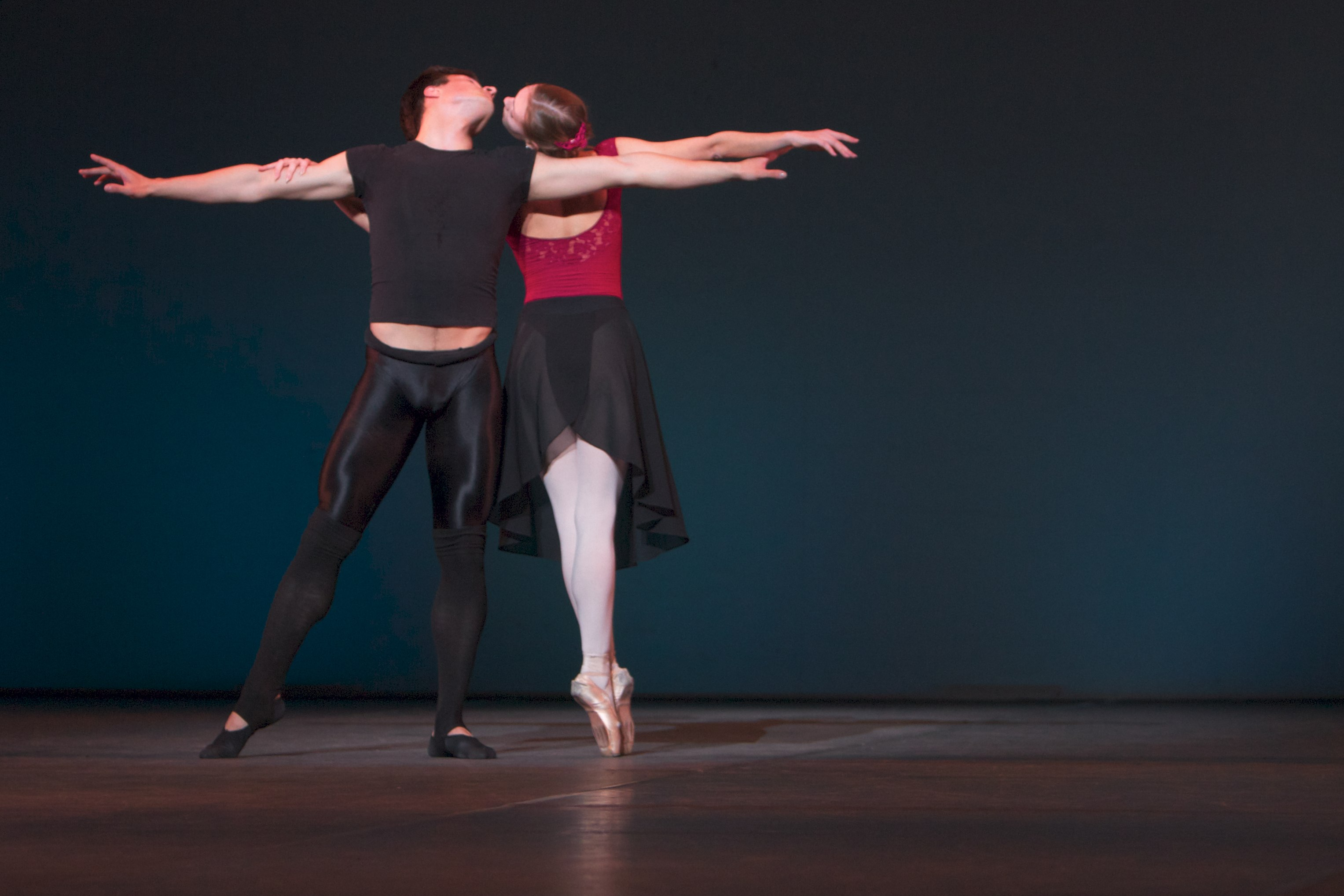 two dancers locked in an embrace on stage