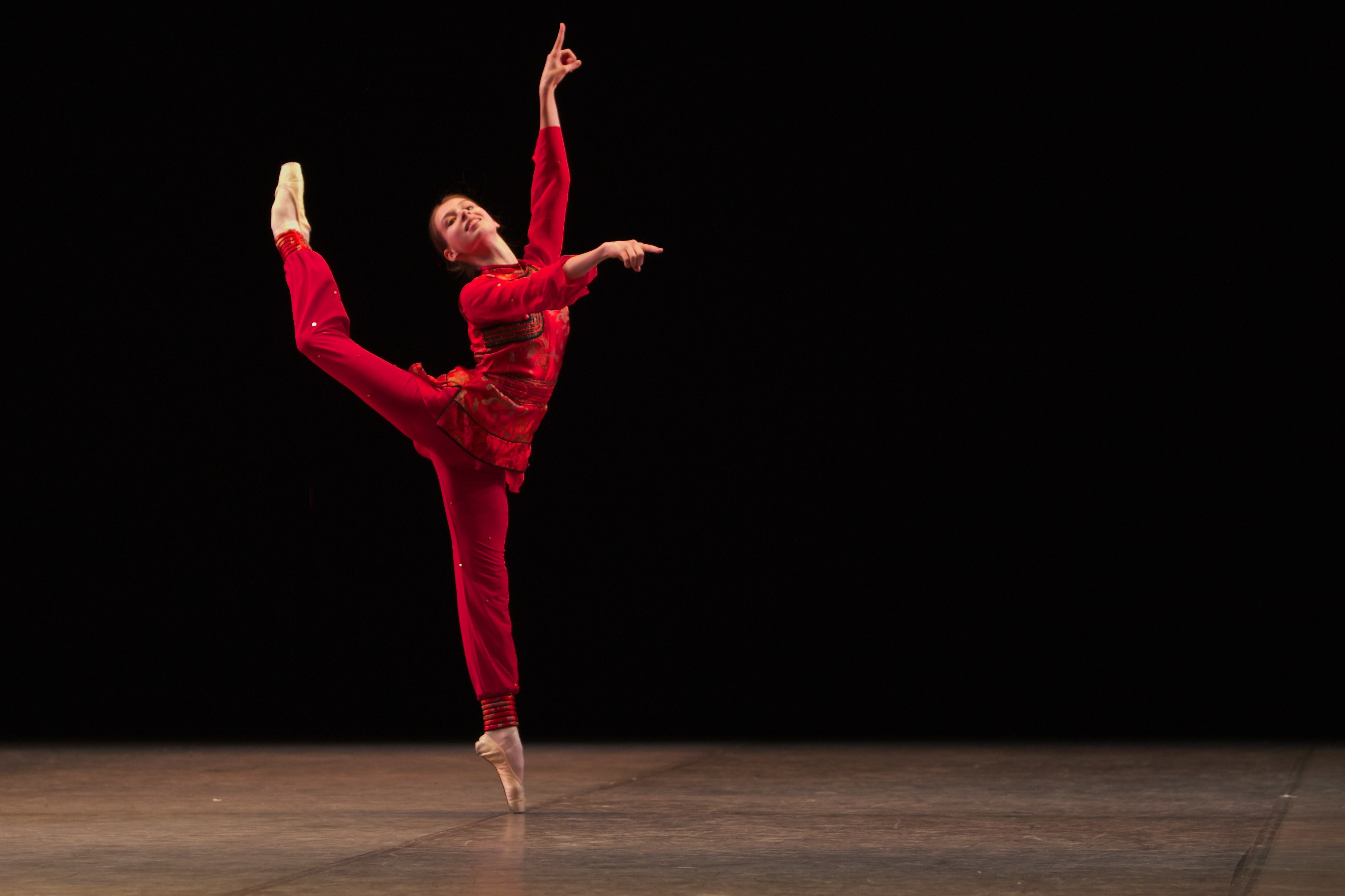 dancer stand on pointe shoes in red costume