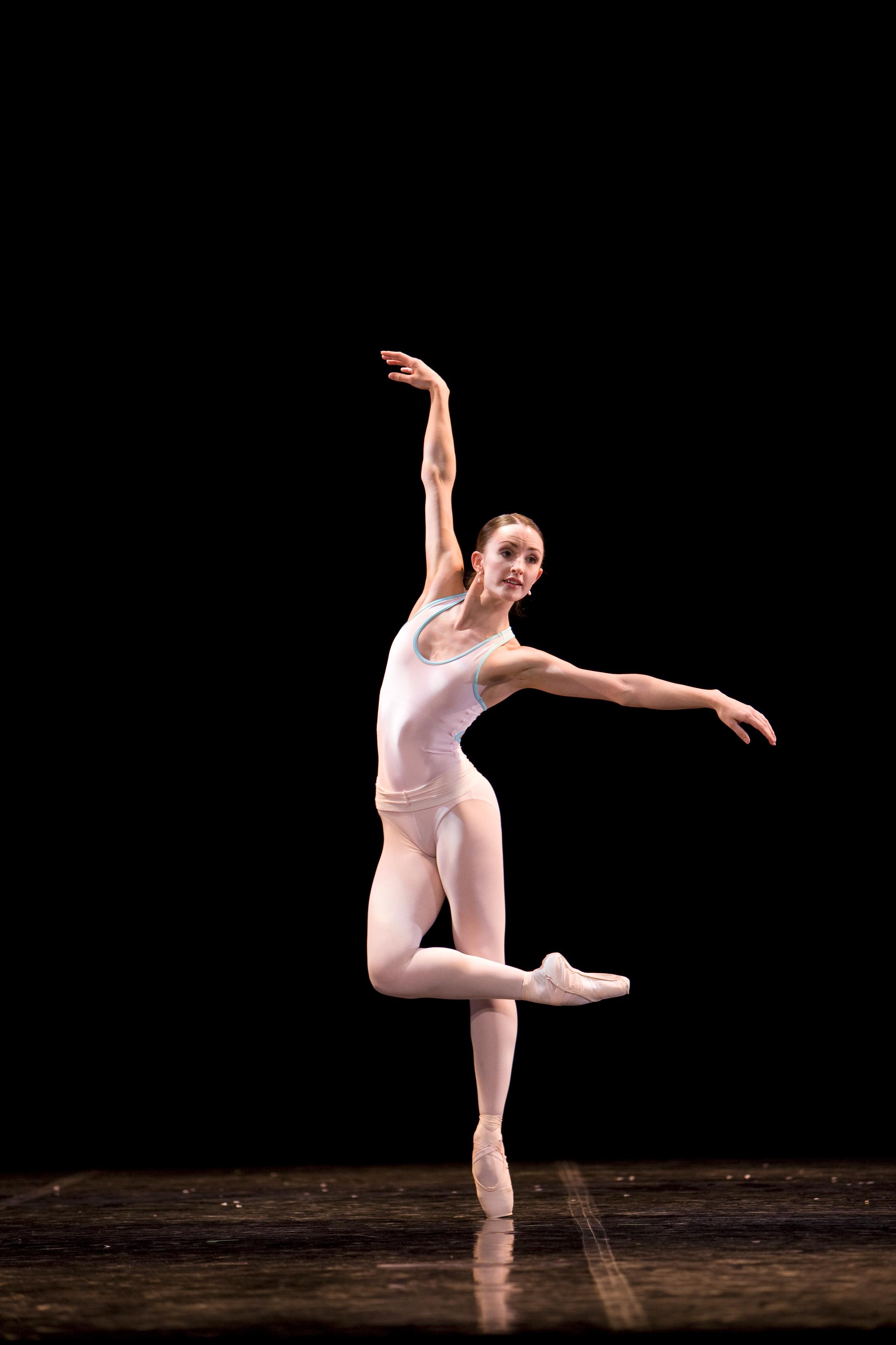 ballet dancer stands on pointe