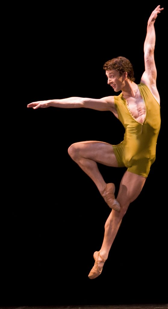ballet dancer jumps high in the air