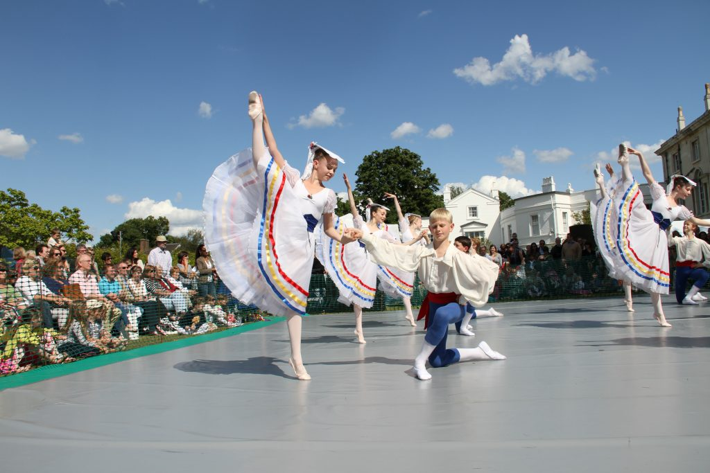 dancers on stage outside in the sun