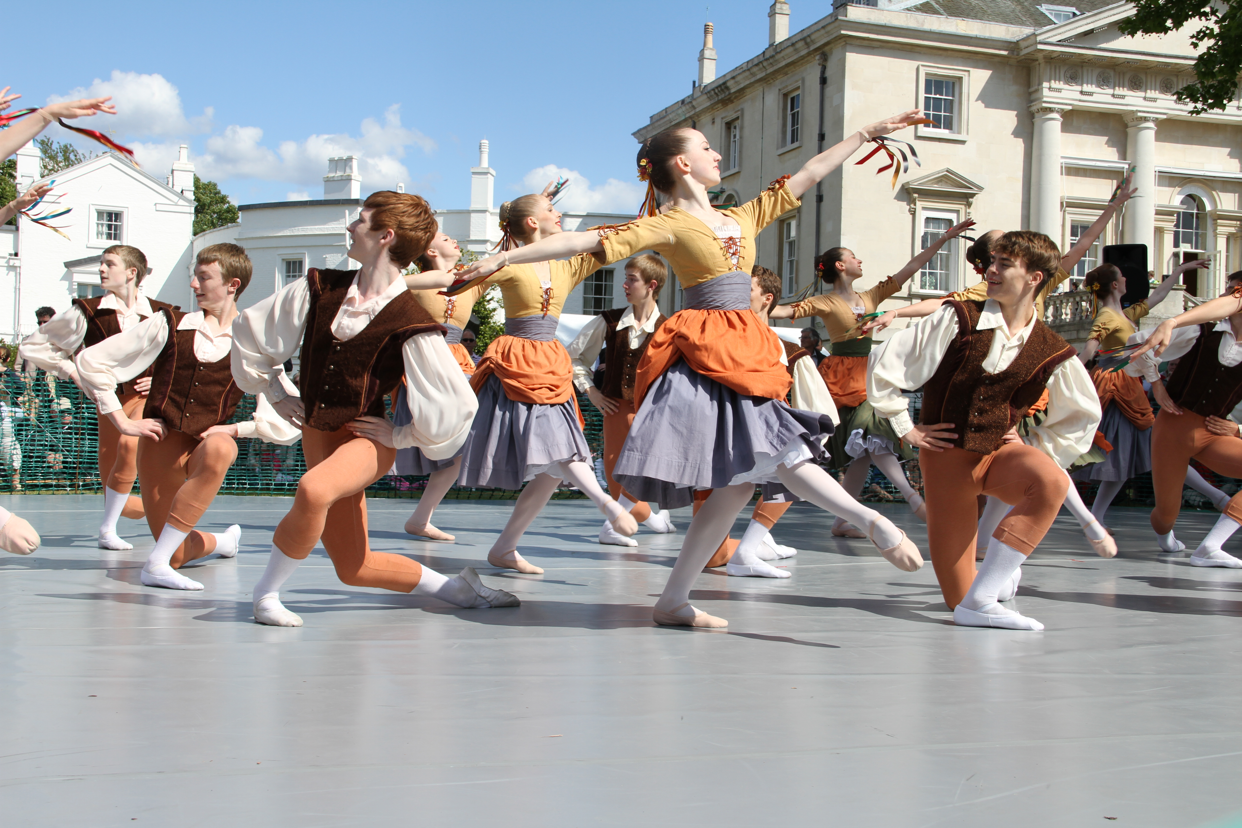 dancers perform outside on the lawn