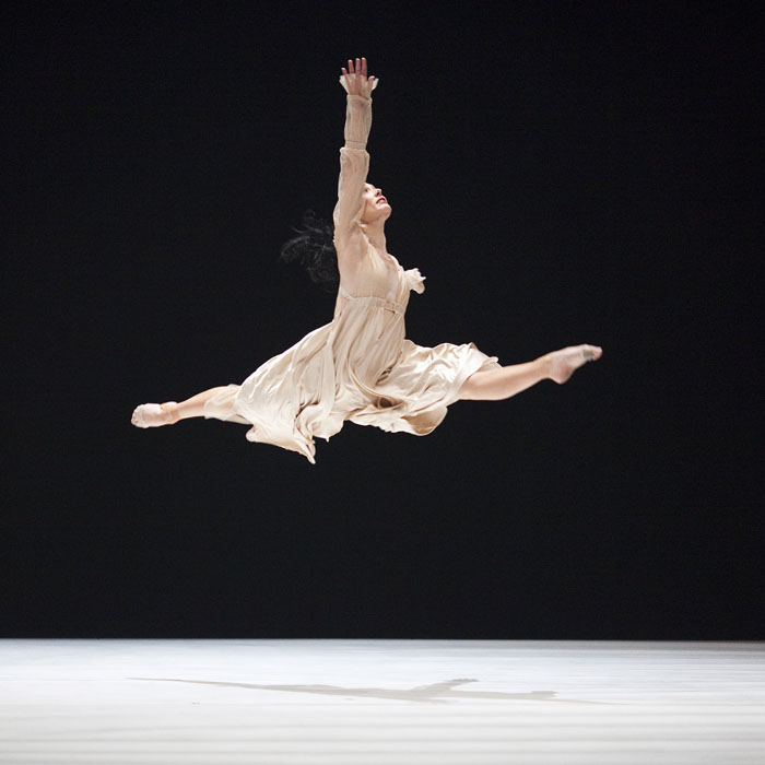 ballet dancer jetes on stage