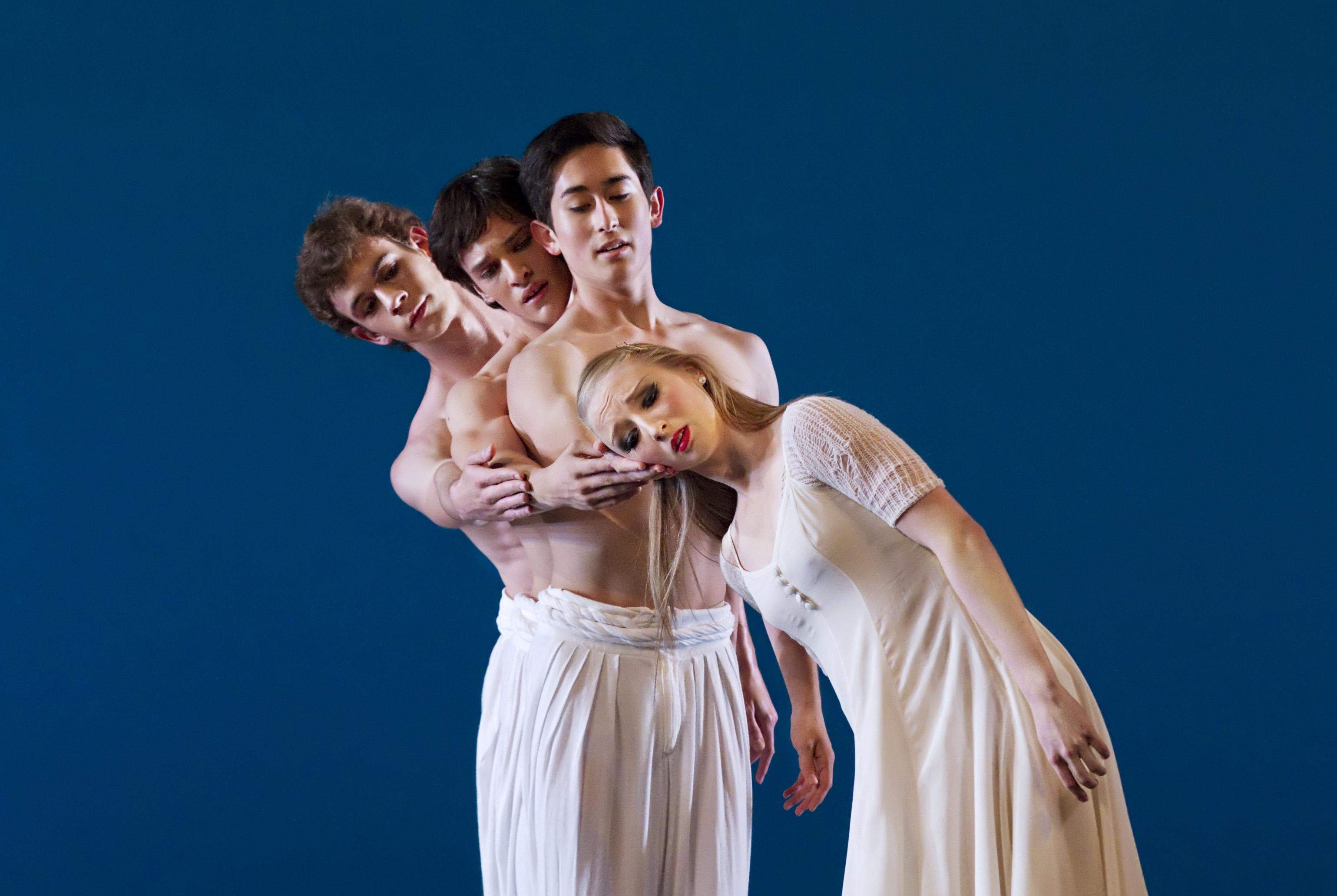 three ballet dancers dressed in white