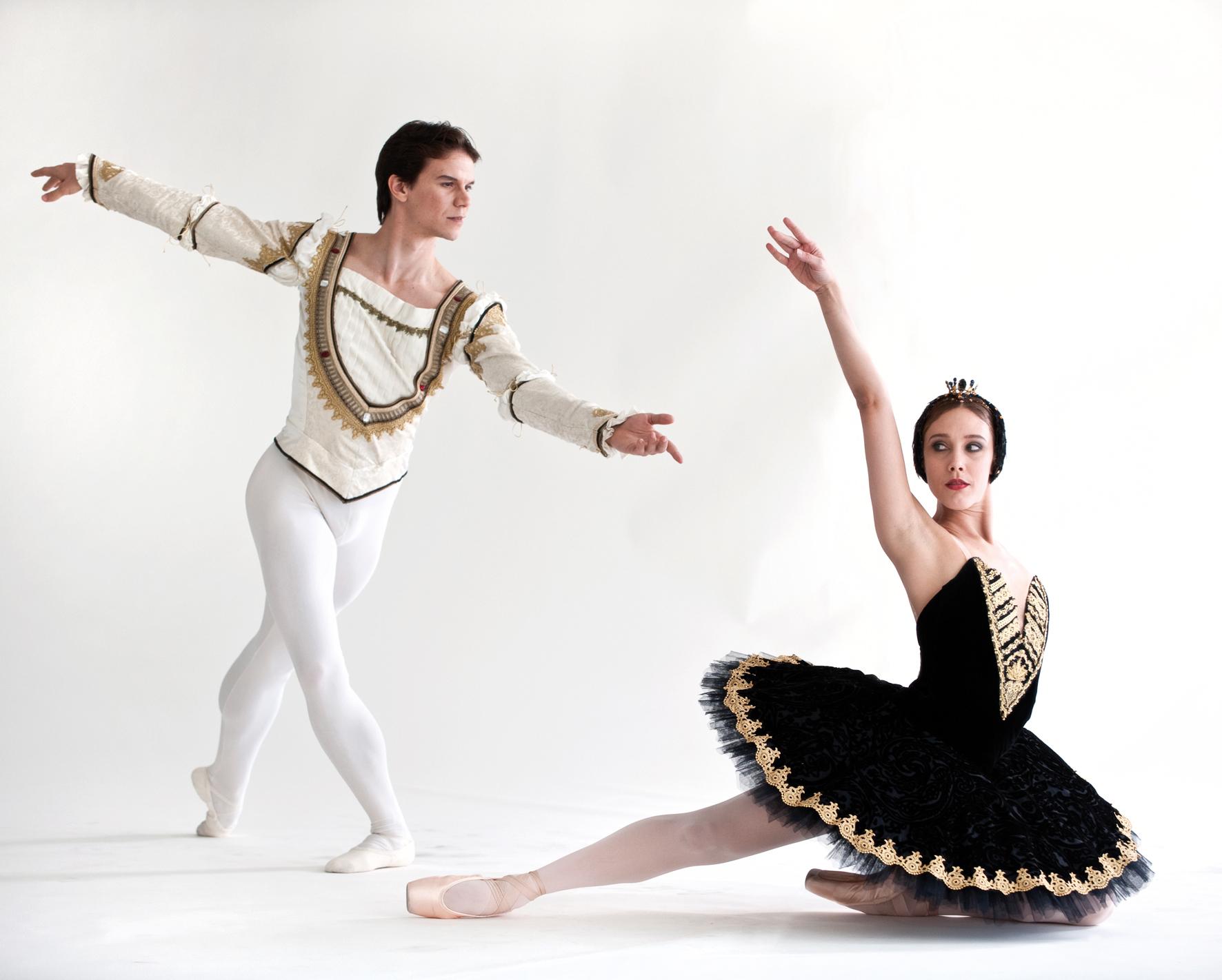 ballet dancer sat on the floor in a black tutu