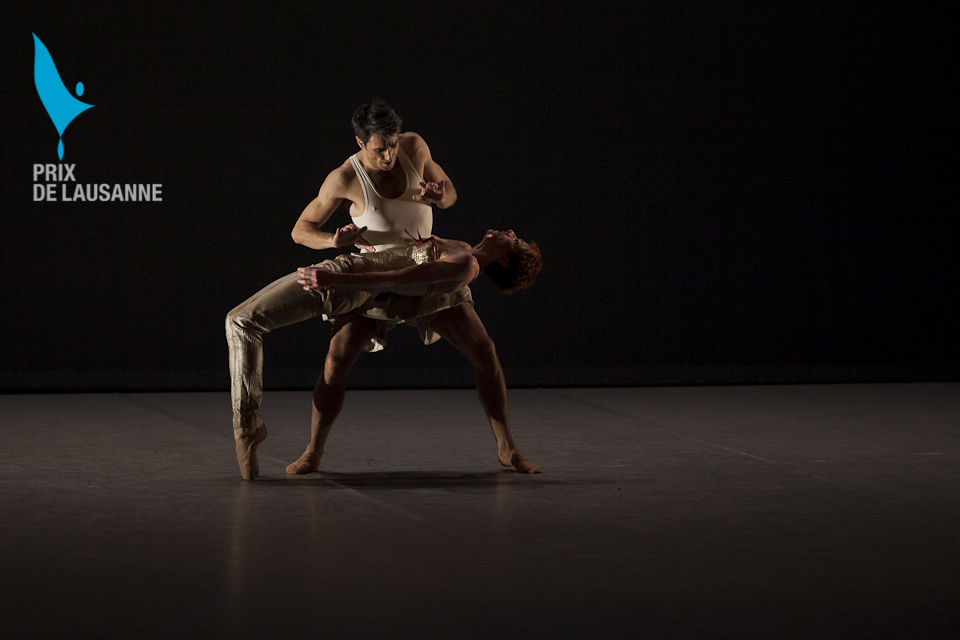 two ballet dancers on stage at the Prix de Lausanne