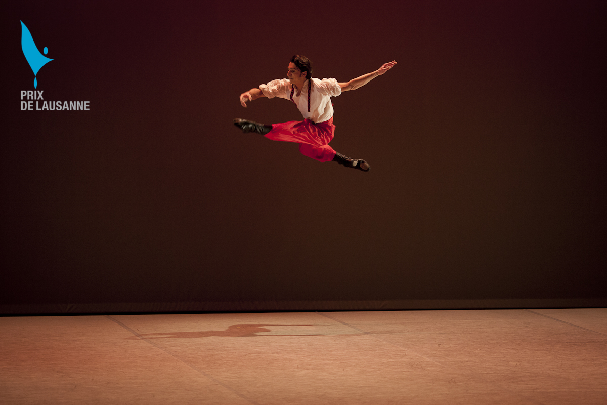 ballet dancer on stage in red trousers