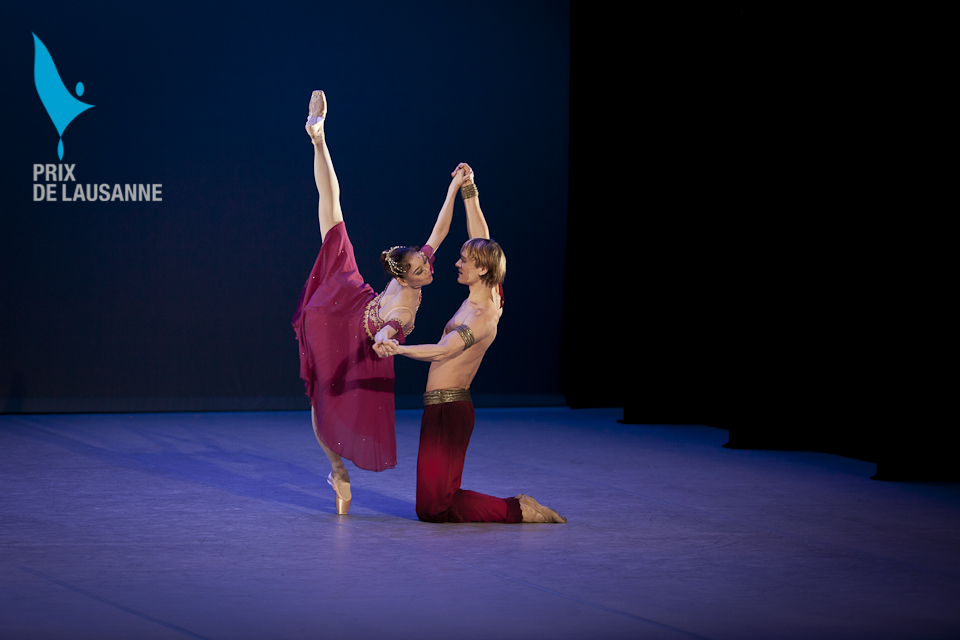 two ballet dancers on stage at the Prix