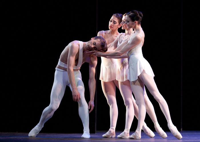 four ballet dancers on stage