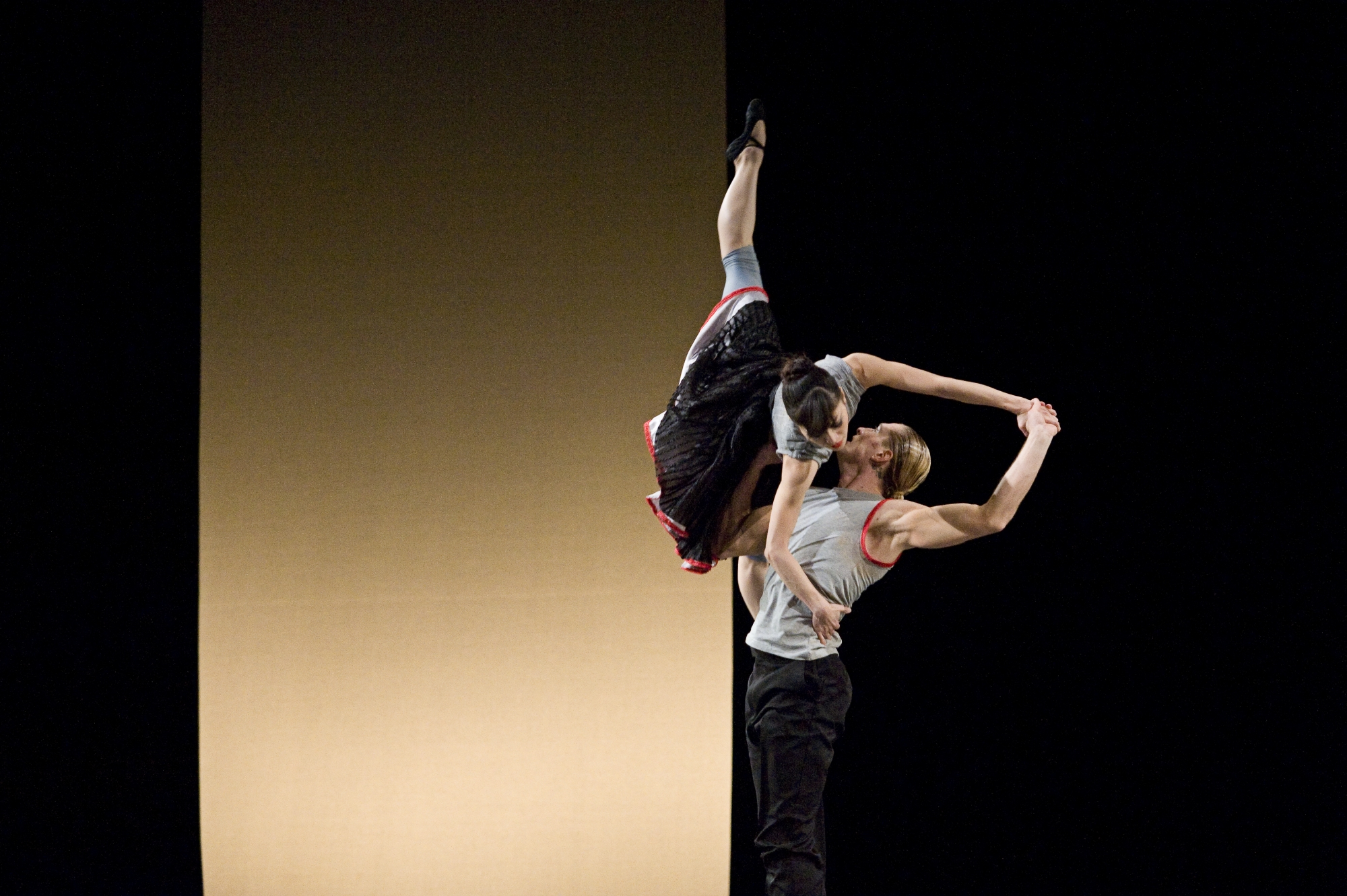 two ballet dancer on stage in a high lift