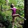 ballet dancer stands on pojnte in a wood