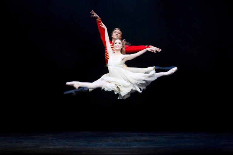 ballet dancer in jete on stage