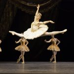 ballet dancer jetes across the stage
