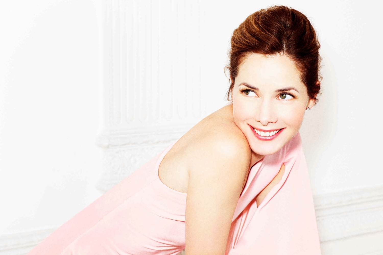 Darcey Bussell smiles to the camera