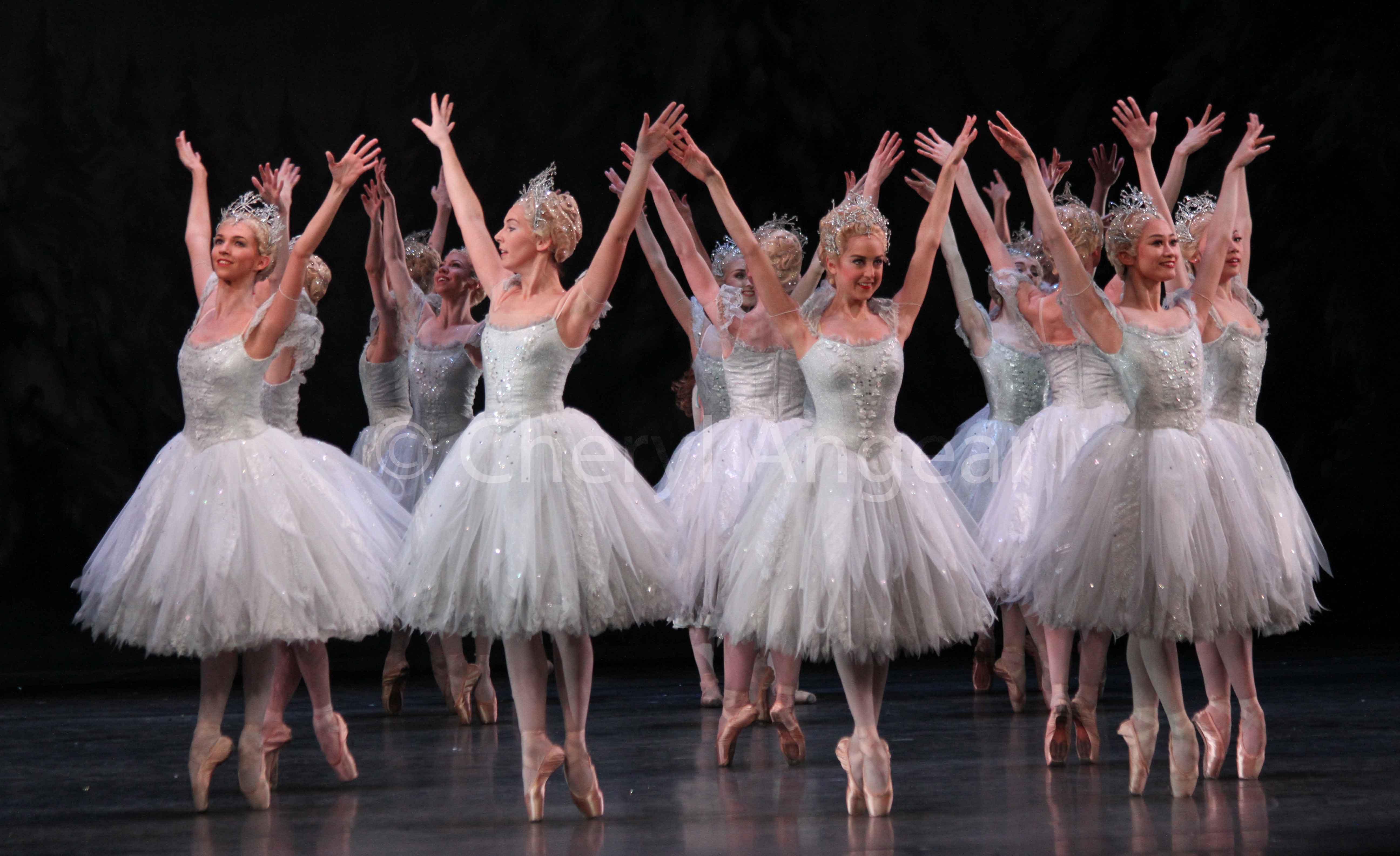 ballet dancers on pointe dressed as snowflakes